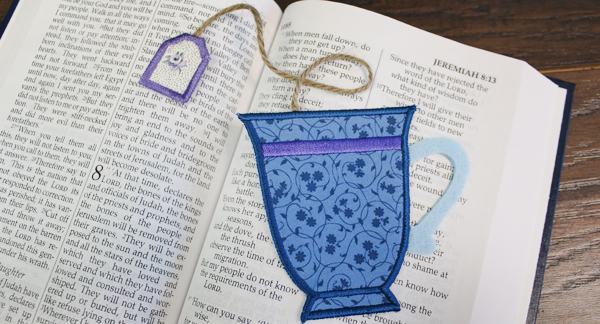Free project instructions for embroidering a in-the-hoop tea time bookmark.