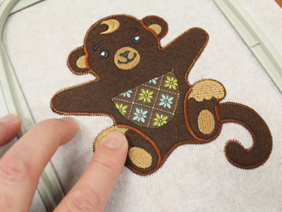 Free project instructions for embroidering a in-the-hoop candy hugger.