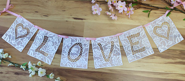 Free project instructions to embroider a freestanding lace bunting.