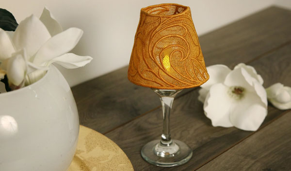 Free project instructions for embroidering a lace wine glass lampshade.