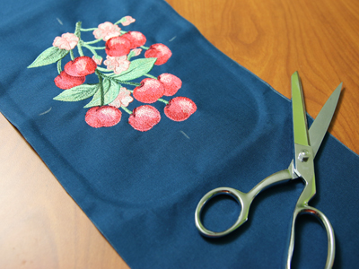 Free project instructions to embroider a beautiful bow pillow.