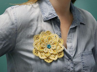 Free project instructions on how to embroider layered battenburg lace flowers.