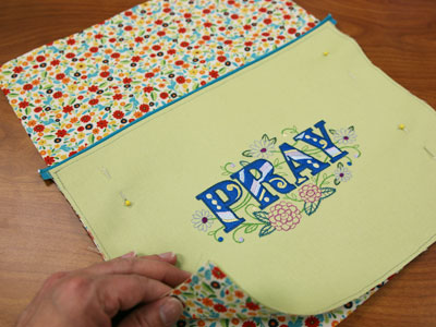 Free project instructions on how to create a prayer pocket pillow.