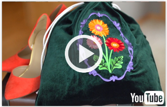 Free video with instructions on how to create an embroidered velvet shoe bag.