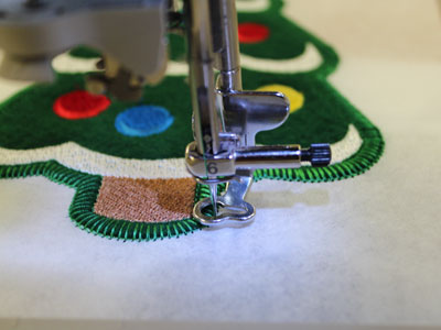 Free project instructions on how to embroider in-the-hoop heirloom stuffed ornaments.
