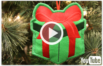 Free video with instructions on how to embroider in-the-hoop heirloom stuffed ornaments.