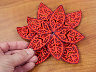 Free project instructions to create a layered lace poinsettia.