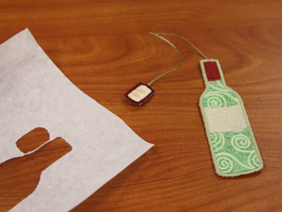 Free project instructions to create an in-the-hoop wine bottle bookmark..
