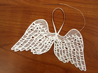 Free project instructions to make Freestanding Lace Wings.