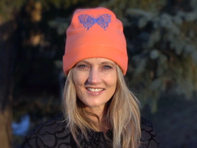 Free project instructions to create an embroidered fleece hat
