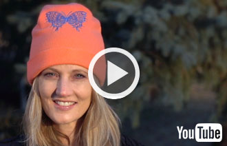 Free project instructions to create an embroidered fleece hat.