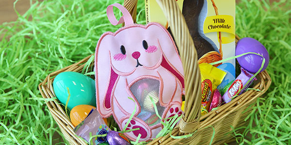 Free project instructions to create an in-the-hoop Easter bunny candy holder.