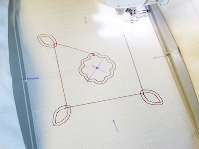 Free project instructions to create a cutwork pillow.