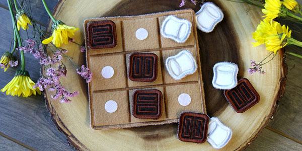 Free project instructions to create a In-the-Hoop S'mores Tic-Tac-Toe Board