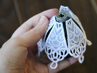 Free project instructions to create a lace & organza ornament cover.