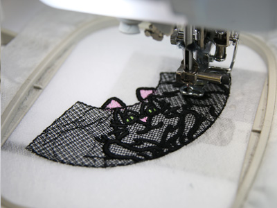 Free project instructions to create a freestanding lace cat.