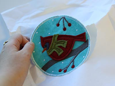 Free project instructions to stitch in-the-hoop applique coasters.
