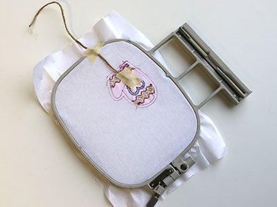 Free project instructions to stitch in-the-hoop ornament pairs.