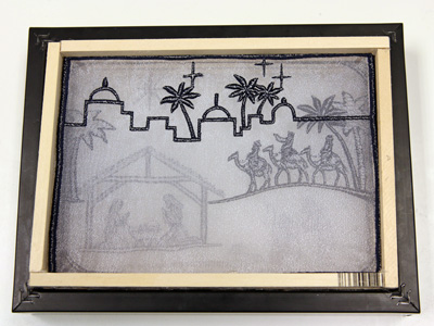 Free project instructions to create an embroidered organza shadowbox.