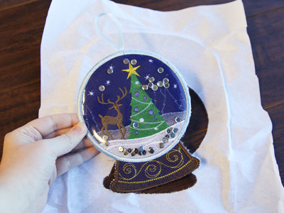 Free project instructions to create a freestanding vinyl snowglobe, in-the-hoop..