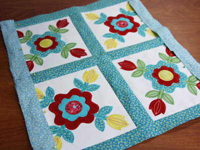 Free project instructions for creating a four-patch quilted pillowl.
