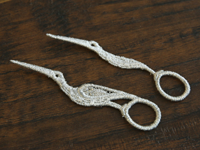 Free project instructions for creating winged lace scissors.