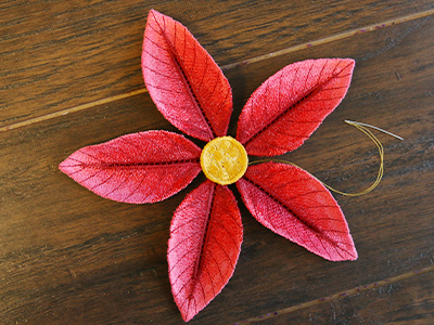 Free project instructions for creating a freestanding poinsettia, in the hoop.
