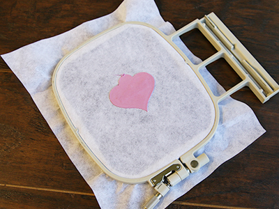 Free project instructions to create an in-the-hoop pet tag.