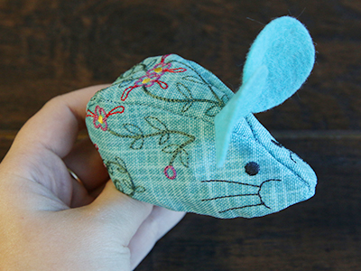 Free project instructions for creating in-the-hoop stuffed mouse.