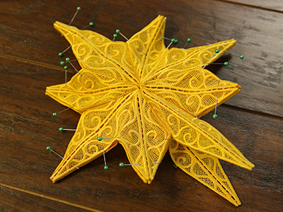 Free project instructions for creating a freestanding lace tree topper.