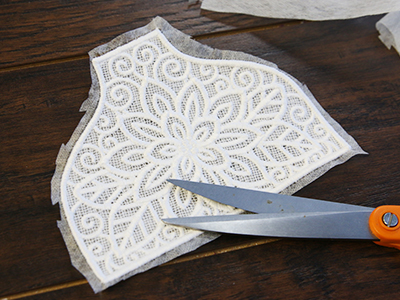 Free project instructions for creating a lace towel topper.