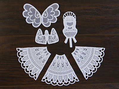 Free project instructions for creating an in-the-hoop organza angel.
