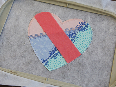 Free project instructions for creating a crazy patchwork trivet, in-the-hoop.
