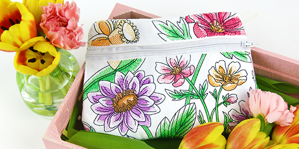 Free project instructions for creating a double sided zipper pouch, in-the-hoop.