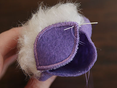 Free project instructions for creating a garden gnome stuffie, in-the-hoop.