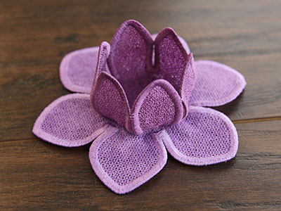 Free project instructions for creating a lace lotus tea light holder.