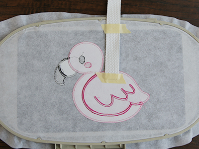 Free project instructions to create an in-the-hoop towel topper set.