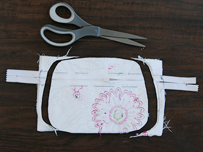 Free project instructions for creating an in-the-hoop double sided applique zipper pouch.