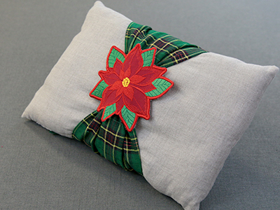 Free project instructions for creating an in-the-hoop pillow wrap.