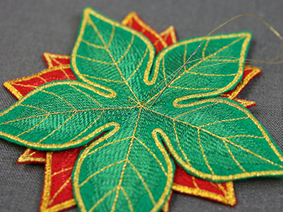 Free project instructions to create a freestanding fabric poinsettia.