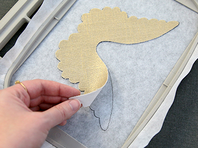 Free project instructions for creating a 3D fabric angel in-the-hoop.