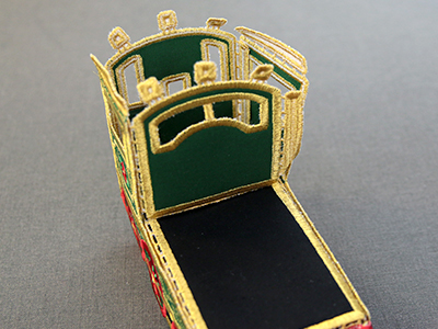 Free project instructions for creating an in-the-hoop 3D Christmas train engine.