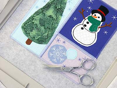 Free project instructions for creating a crafty cut applique trivet in-the-hoop.