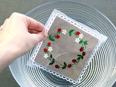Free project instructions for creating an in-the-hoop lace edge coaster.