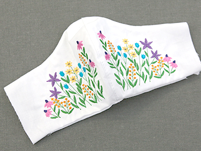 Free project instructions for creating an embroidered shaped face mask.