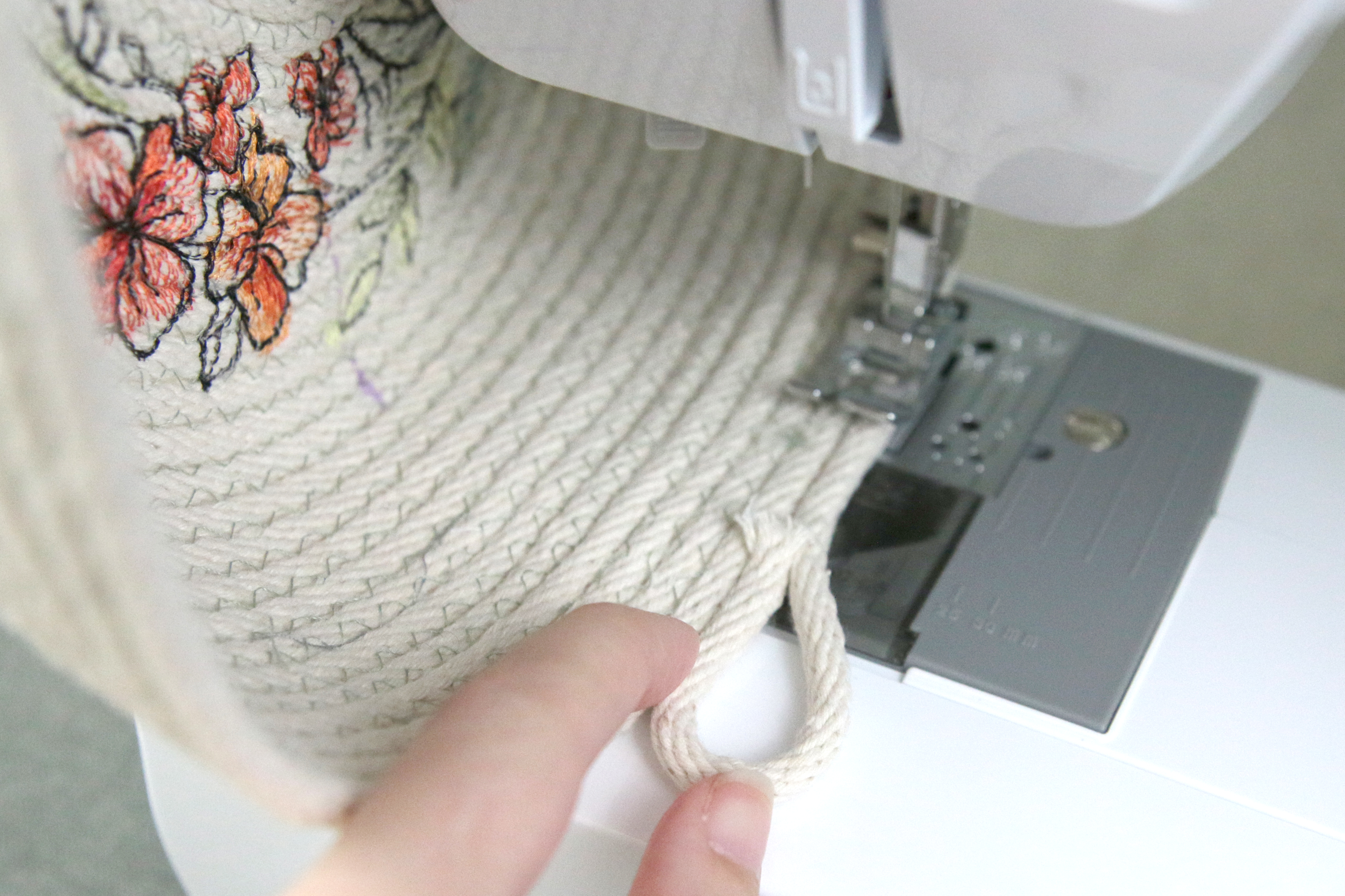 Free project instructions for creating an embroidered rope basket.