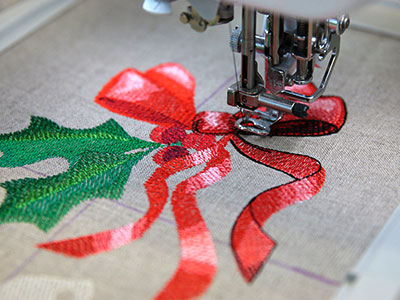 Free project instructions for creating an embroidered drawstring gift bag.