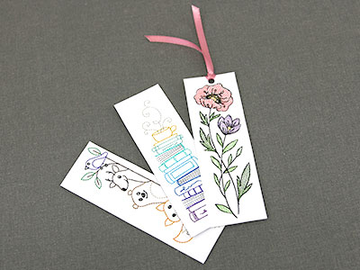 Free project instructions for an embroidered cardstock bookmark.