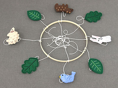 Free project instructions for hand embroidery hoop mobile.
