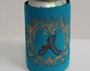 This can koozie features a letter from the Grand Flourish alphabet.